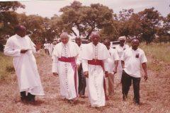 Fr. Peter Dakura, the Nuncio Archbishop George Kocherry, Bishop Paul Bemile (Emeritus now), Mr. Baarekoh and some parishioners of St. Benedict parish: on the way to the new site of the parish